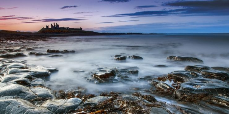 Northumberland Coastal Route featured by top international travel blog, Tracy's Travels in Time: image of Dunstanburgh Castle near Craster Northumberland