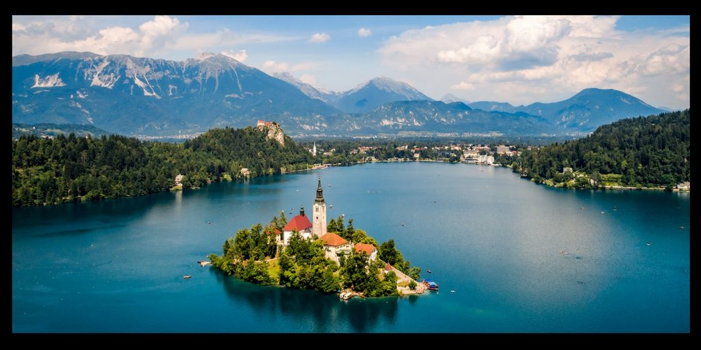 Top 20 Beautiful Places in Europe to Visit featured by top international travel blogger, Tracy's Travels in Time: lake bled slovenia