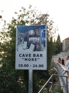 sign for the Cave bar Best things to do in Dubrovnik featured by international travel blog, Tracy's Travels in Time