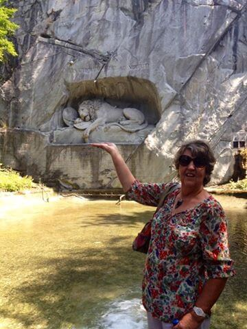My mother at the Lion Monument in Lucerne | Golden round trip to Mount Pilatus featured by top international travel blogger, Tracy's Travels in Time