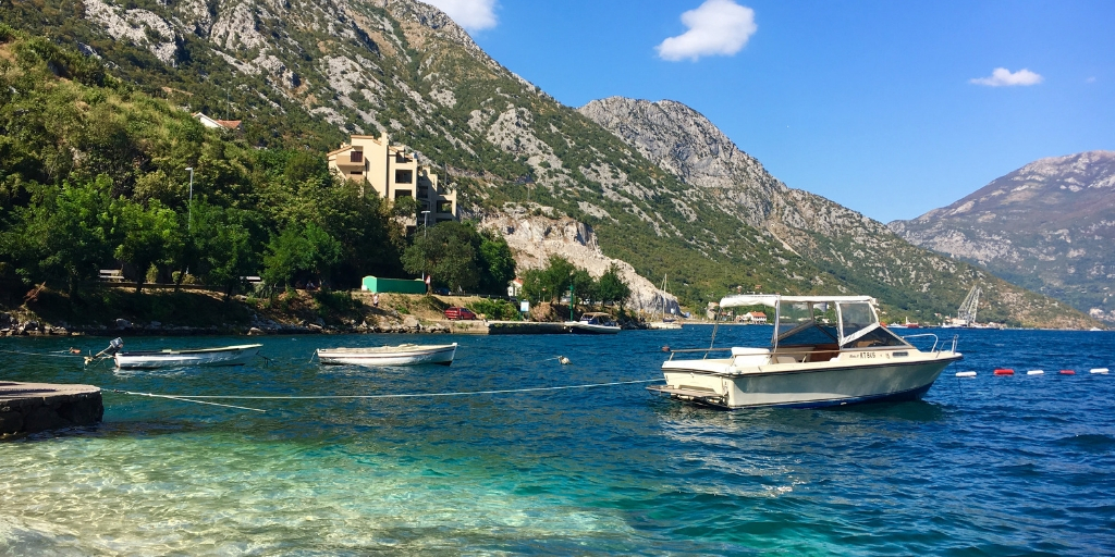 Kotor Bay and a boat - Montenegro-day-trip-from-Dubrovnik