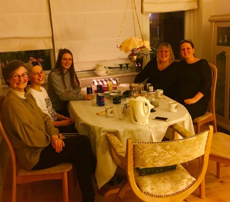 A Danish family sit around the table