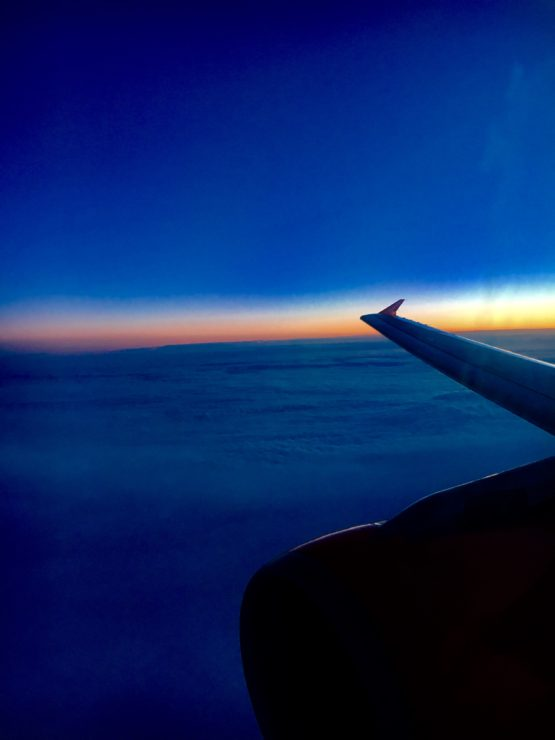 a view of sunset from an airplane