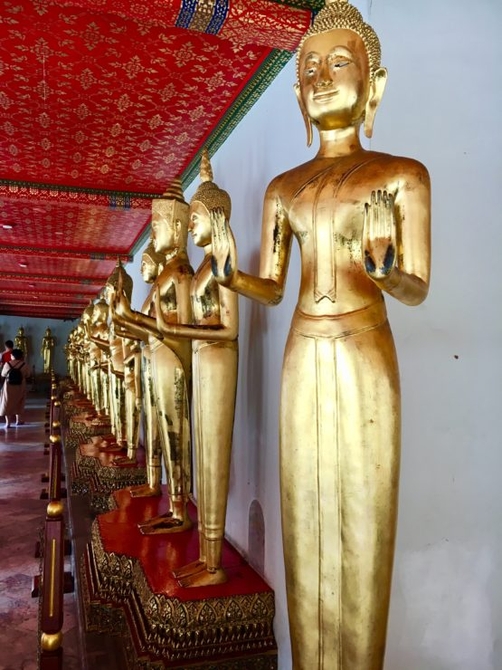 a buddhist statue in thailand best travel experiences
