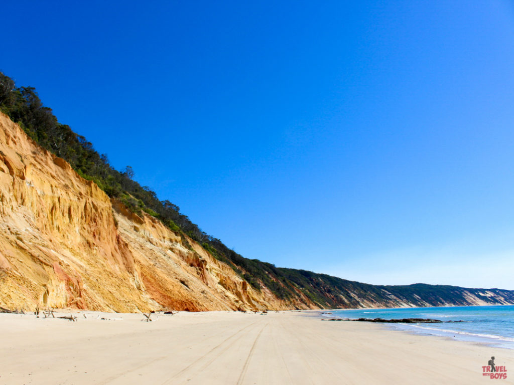   The Best Things to Do in Queensland Australia featured by top international travel blogger, Tracy's Travels in Time: rainbow beach one of many things to do in Queensland
