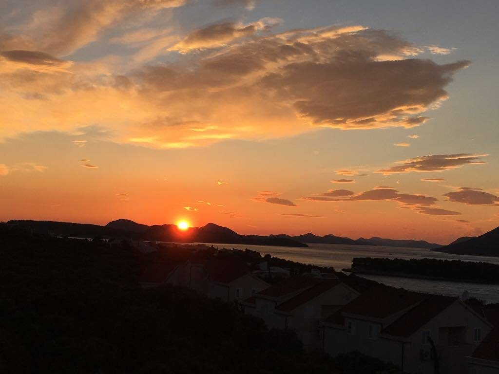 sunset over the Elafiti IslandsBest things to do in Dubrovnik featured by international travel blog, Tracy's Travels in Time