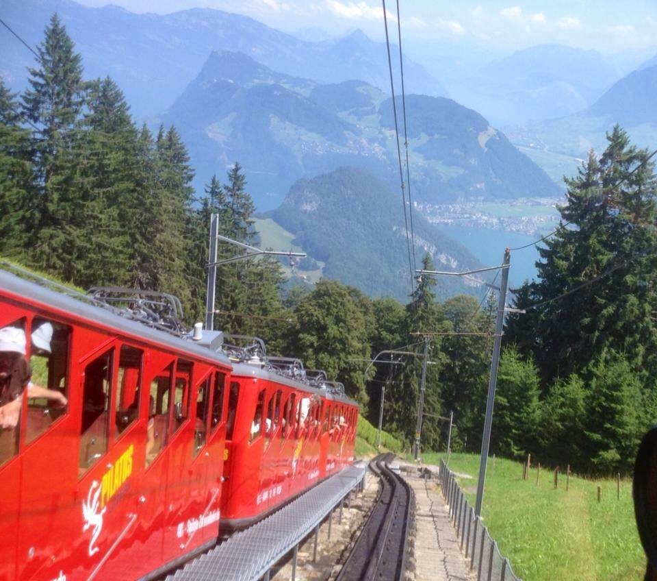 being passed on the mountain side by another coach on its way down Mt Pilatus | Golden round trip to Mount Pilatus featured by top international travel blogger, Tracy's Travels in Time