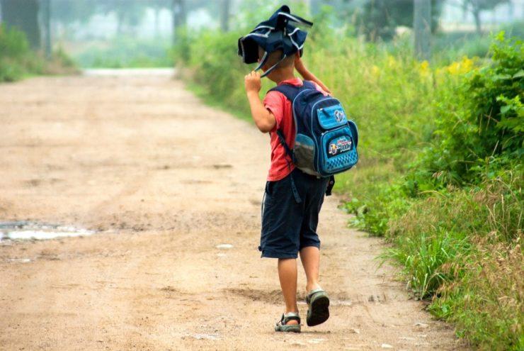 school boy going to school