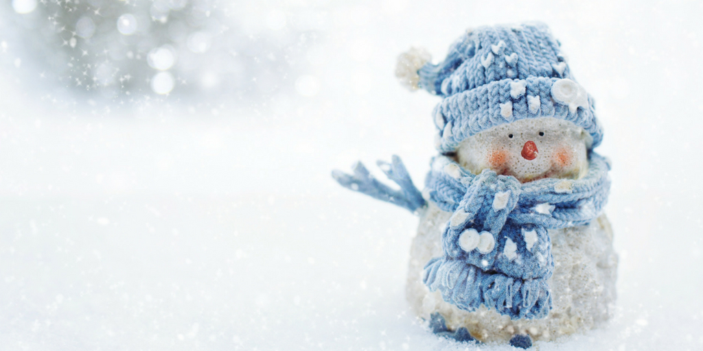 a snowman with a blue hat and scarf