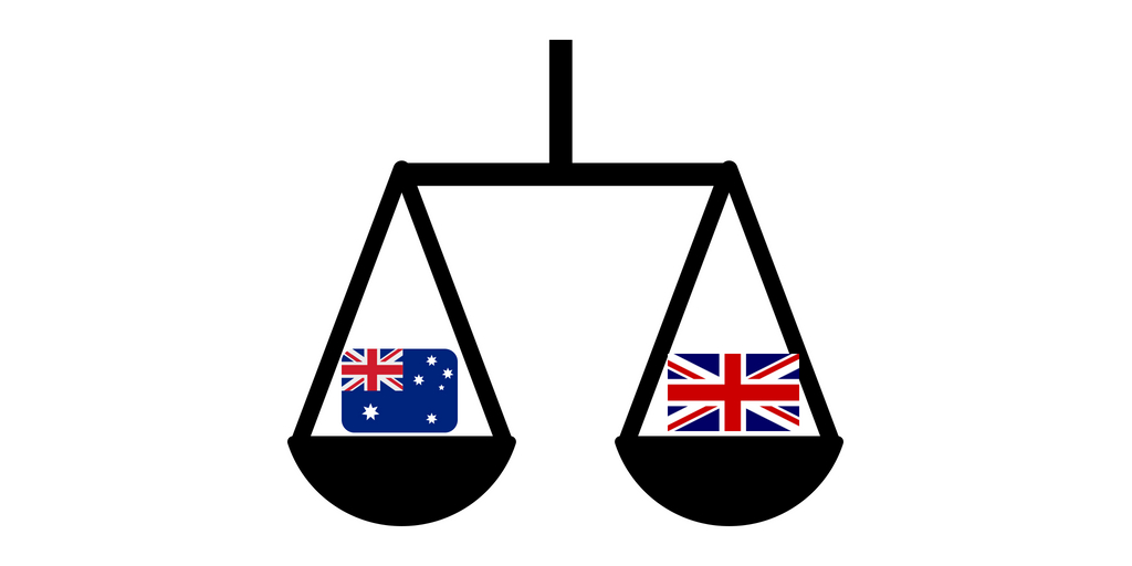 scales with a UK flag and an Australian flag