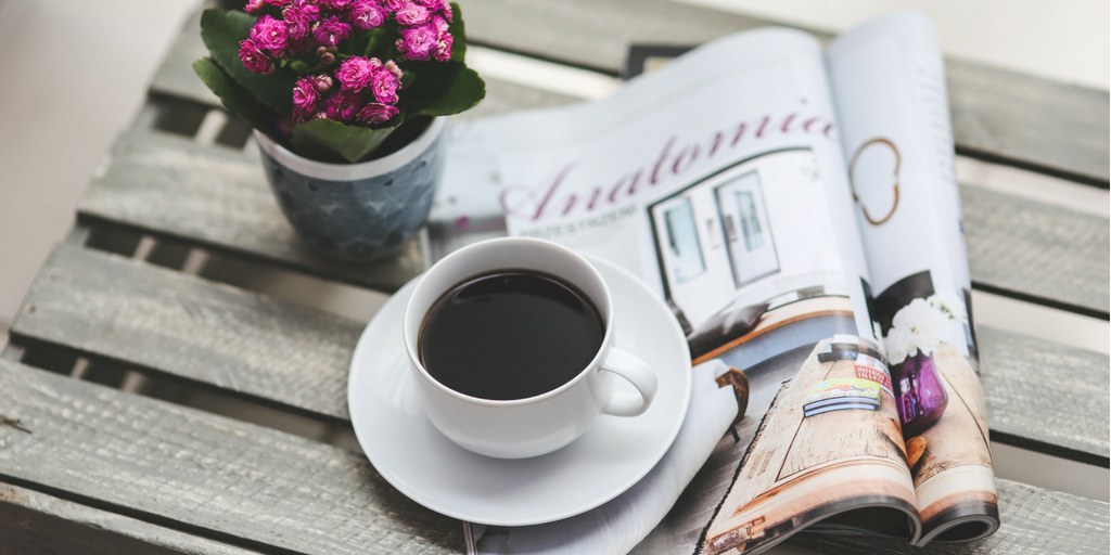 magazine and a cup of coffee