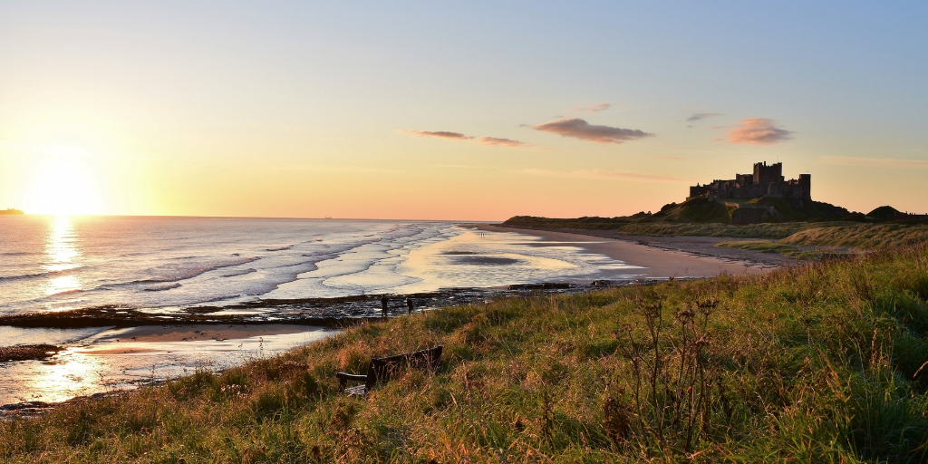 6 of the Best Northumberland Castles to Visit featured by top international travel blogger, Tracy's Travels in Time: image of Bamburgh Castle