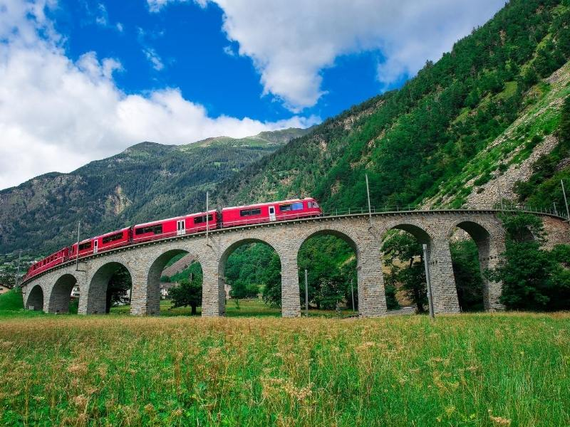 The Bernina Express in Switzerland loops around on a bridge