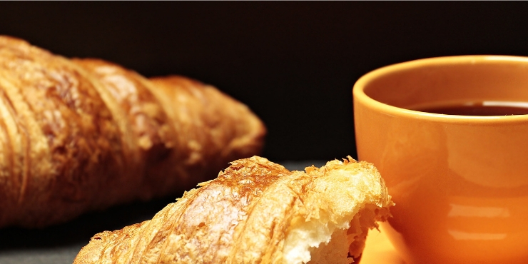 croissants and a cup of coffee