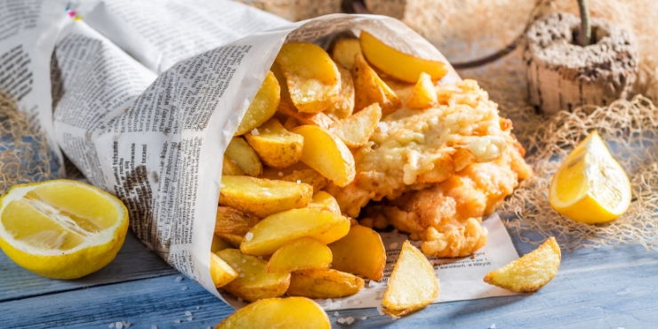 traditional English food - fish and chips in newspaper