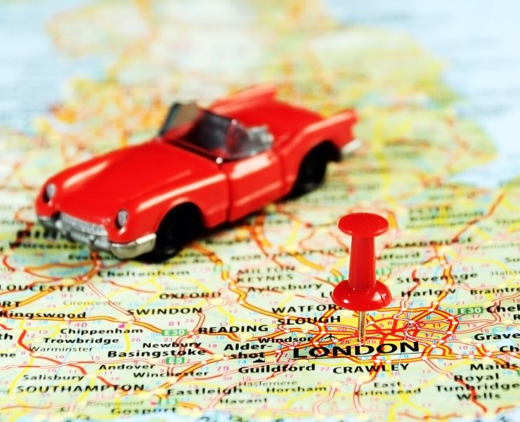 Red car on a map of the UK