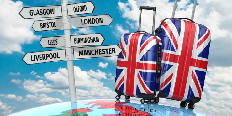 UK travel tips - signs for the UK and 2 suitcases