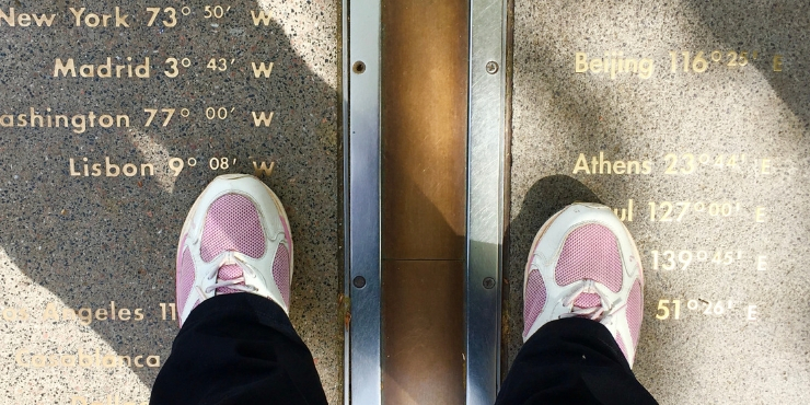Standing on the Greenwich Meridian a foot in each hemisphere