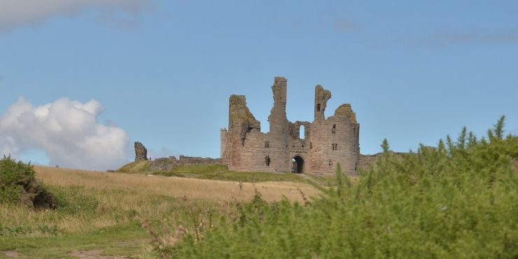 6 of the Best Northumberland Castles to Visit featured by top international travel blogger, Tracy's Travels in Time: image of Dunstanburgh Castle Northumberland