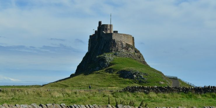 6 of the Best Northumberland Castles to Visit featured by top international travel blogger, Tracy's Travels in Time: image of Lindisfarne Castle in Northumberland England - NORTHUMBERLAND CASTLES
