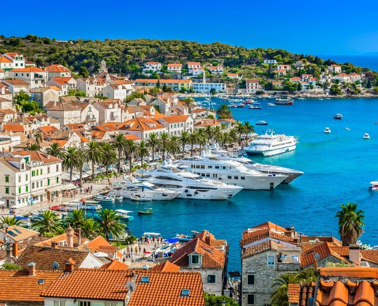 A Complete Guide to How and Where to Travel in Croatia by Ferry or Catamaran featured by top international blogger, Tracy's Travels in Time: The port of Hvar