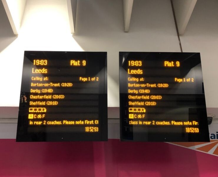 Electronic departure boards in a UK train station