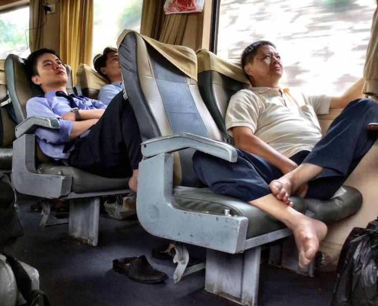 Passengers on the Reunification Express in Vietnam