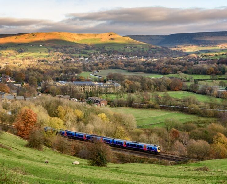 A train traveling through the English countryside