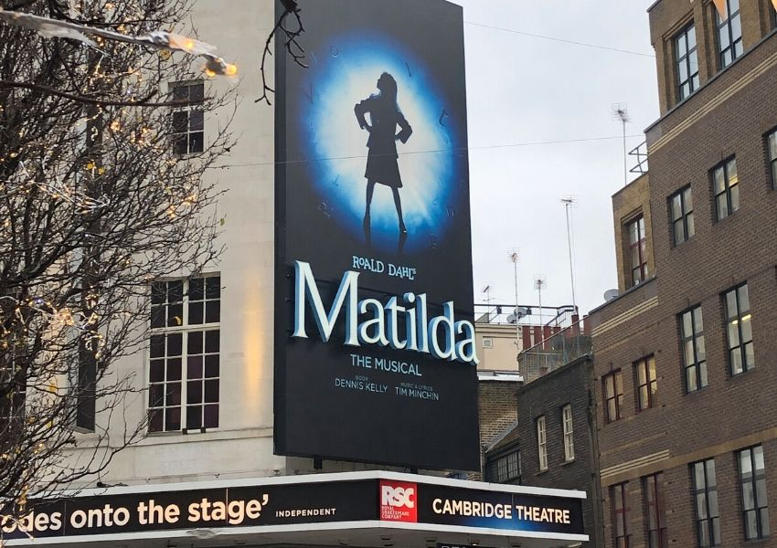 Cambridge theatre london showing the sign for Matilda