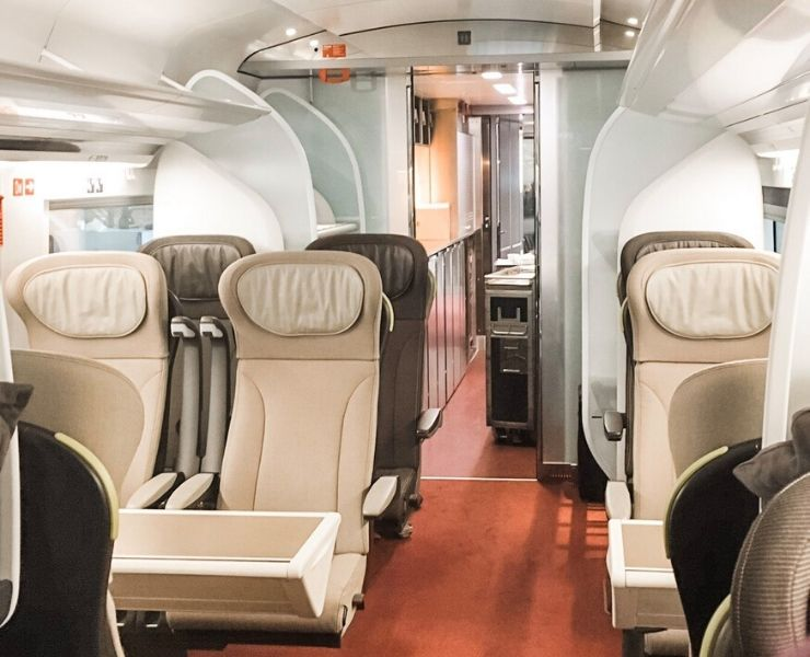 Inside a Eurostar train with comfortable chairs