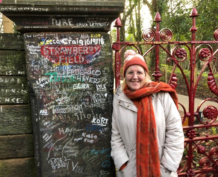 Standing at the gates of Strawberry Field in Liverpool