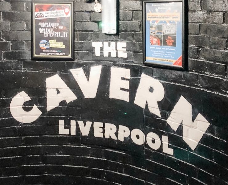 The words 'The Cavern Club' written on a wall