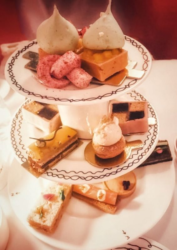 Sketch afternoon tea with cakes and savouries on a three tier plater