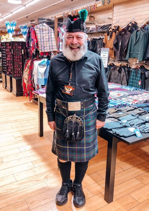A man dressed in a tartan kilt