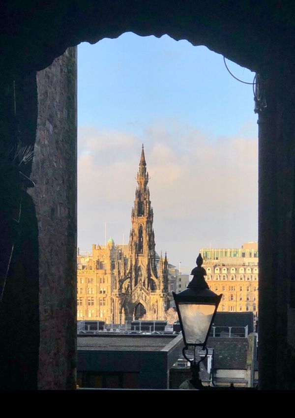Scott Monument in Edinburgh seen through an alleyway