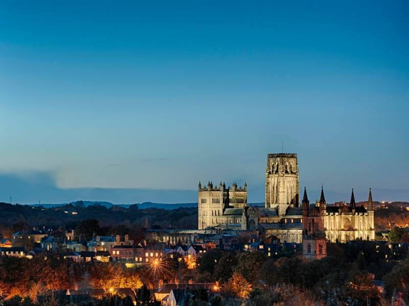 Durham Cathedral with the night sky and lights of Durham