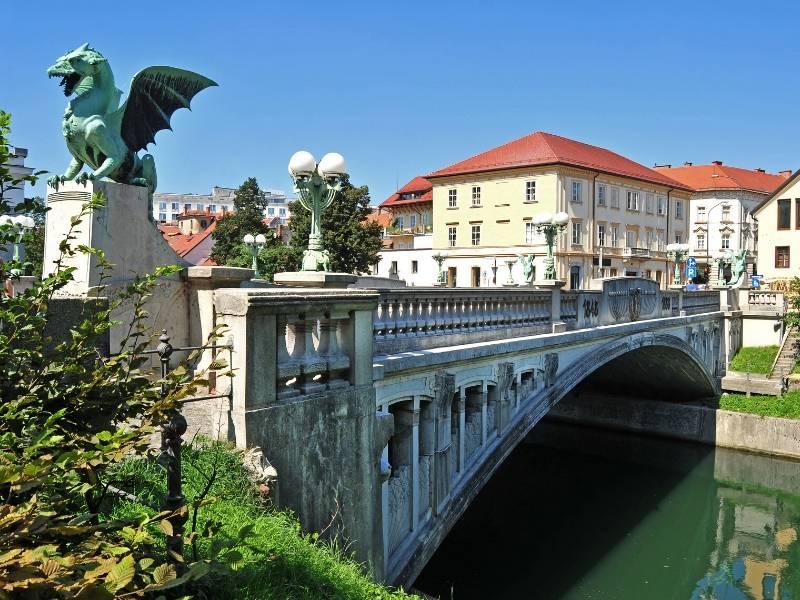 A bridge with dragon statues along it in Ljubljana
