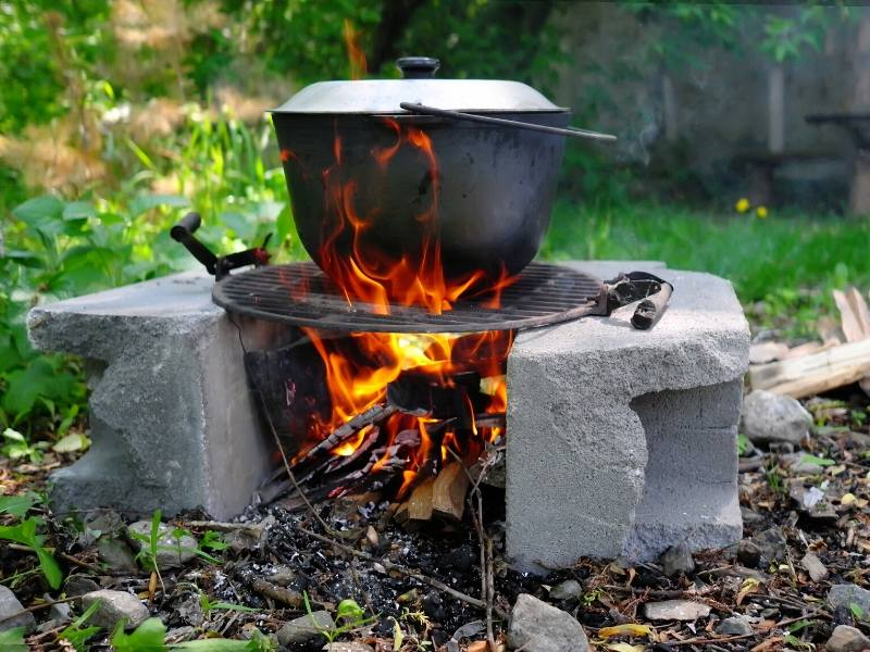 A black cooking pot on a fire