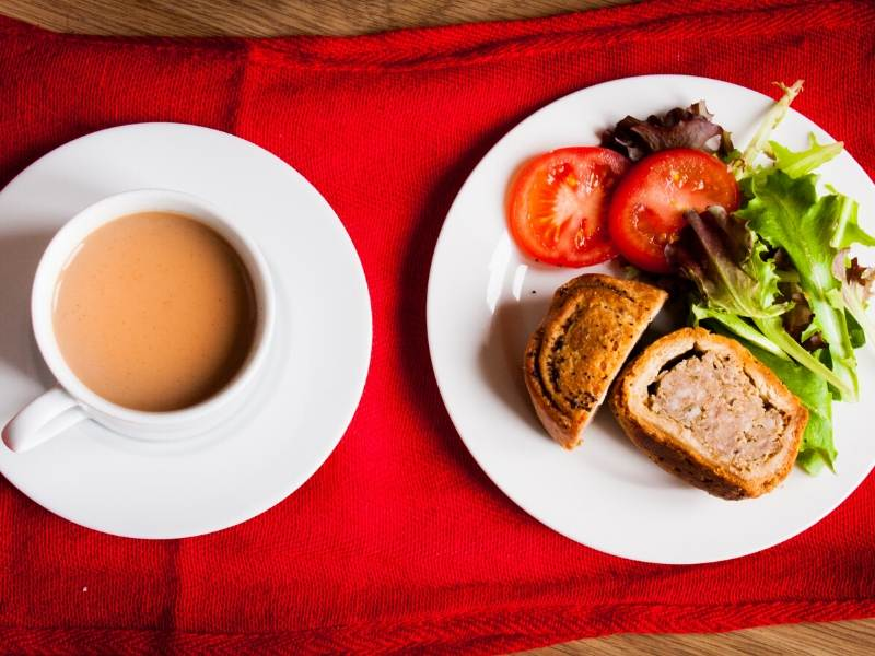 Pork pie with salad and a cup of tea