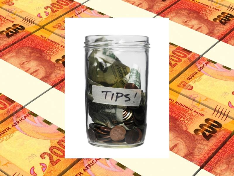 South African money and a tip jar