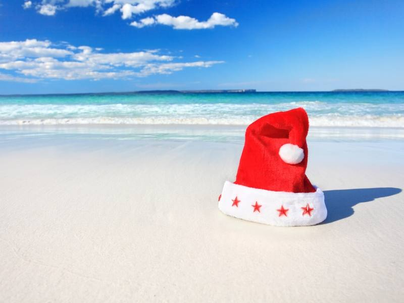 A Santa hat on a beach
