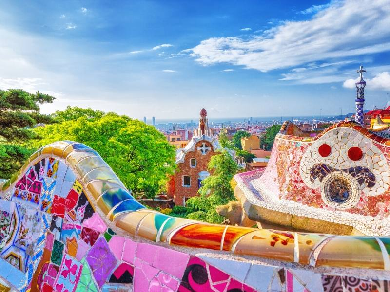 Parc in Barcelona by Gaudi with bright coloured tiles decorating the walls