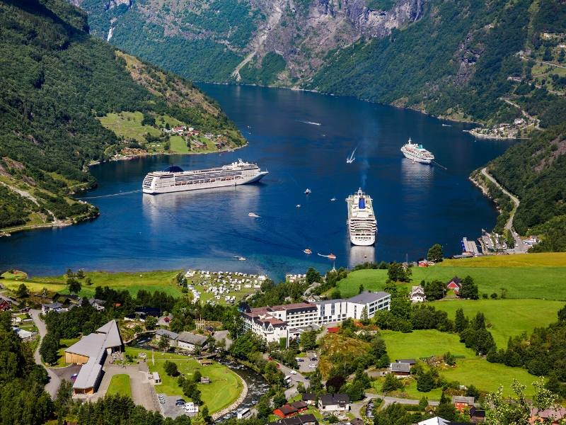 An aerial view of the fjords in Norway with some cruise ships