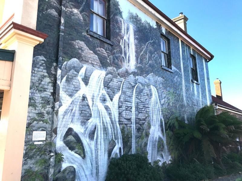 Street art in Tasmania of a waterfall