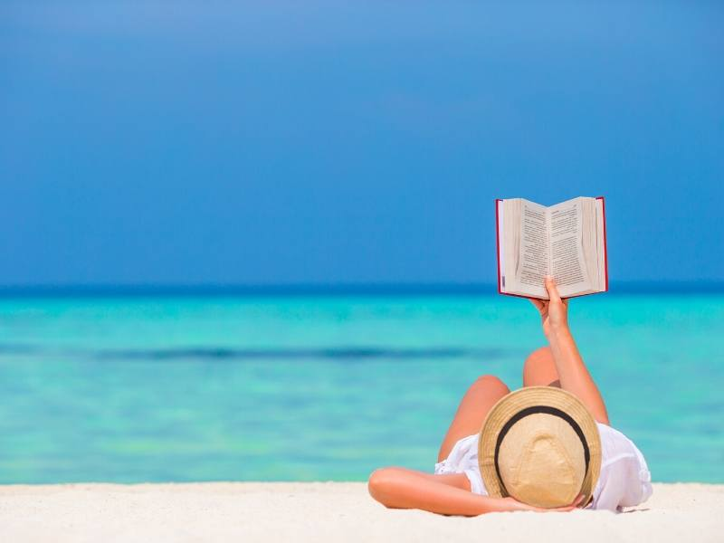 Reading a book on a beach