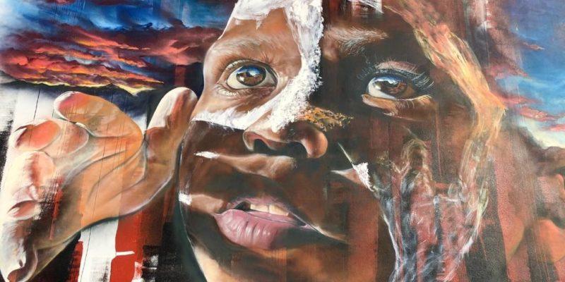 A street art picture of a boy