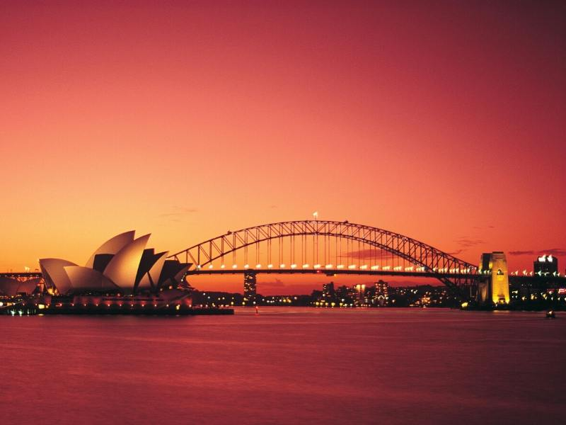 Sydney and the Opera House and Bridge at sunset