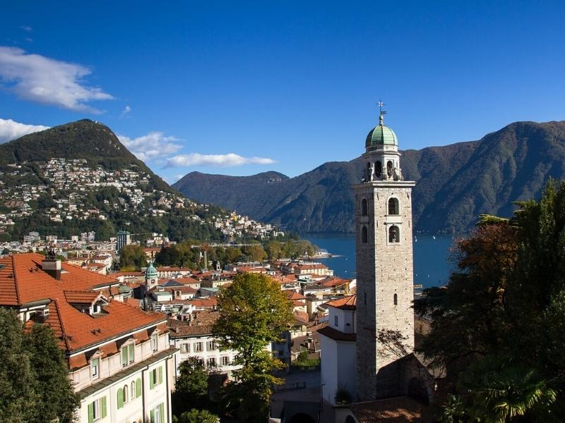Beautiful city of Lugano in Switzerland with the lake and mountains