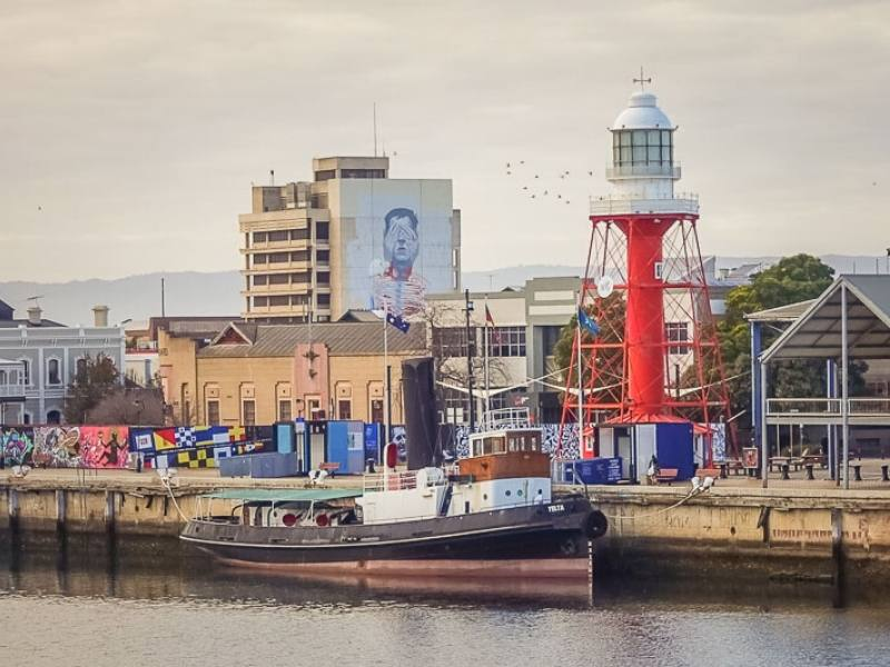 Murals and a boat in the Port of Adelaide