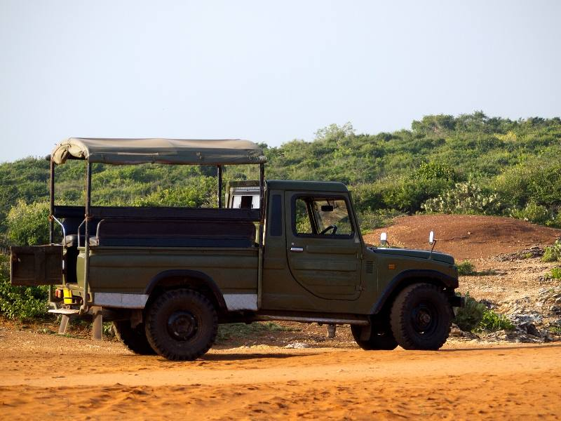 Think about what to wear on safari in South Africa as the open sides on the jeep as shown in the picture can mean it can be very cold